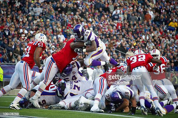Minnesota Vikings Adrian Peterson in action going over the top for touchdown vs New England Patriots Foxborough MA CREDIT Lou Capozzola