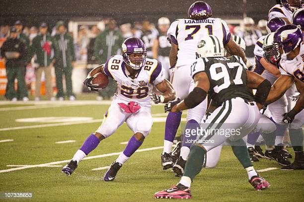 Minnesota Vikings Adrian Peterson in action rushing vs New York Jets at New Meadowlands Stadium East Rutherford NJ CREDIT John Iacono
