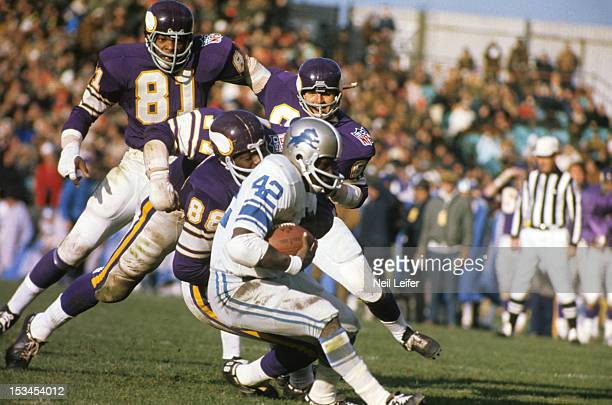 Minnesota Vikings Carl Eller Alan Page Gary Larsen and Roy Winston in action vs Detroit Lions Altie Taylor at Metropolitan Stadium Cover Bloomington...