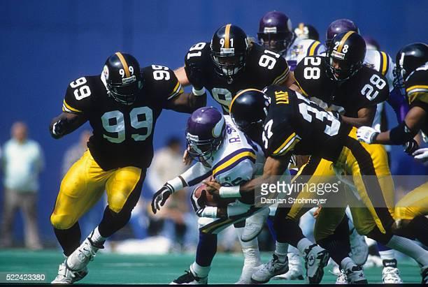 Minnesota Vikings Robert Smith in action rushing vs Pittsburgh Steelers Cornell Lake Kevin Greene and Levon Kirkland at Three Rivers Stadium...