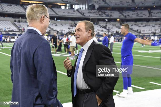 NBC Football Night in America play by play announcer Al Michaels talking with New York Giants owner John Mara on field before game vs Dallas Cowboys...