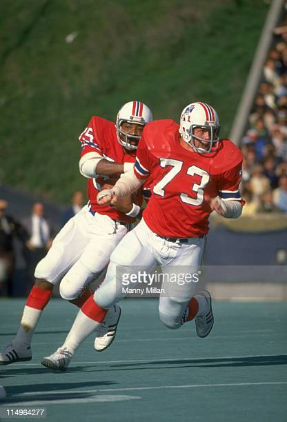 New England Patriots John Hannah in action action blocking and leading the sweep for Jess Phillips vs Oakland Raiders at Schaefer Stadium Foxborough...