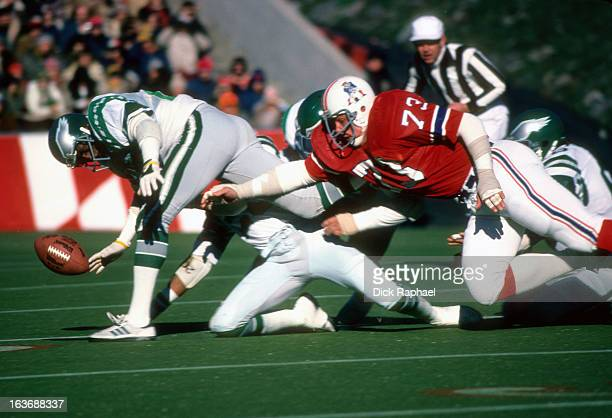 New England Patriots John Hannah in action attempting to recover fumble vs Philadelphia Eagles at Schaeffer Stadium Foxborough MA CREDIT Dick Raphael
