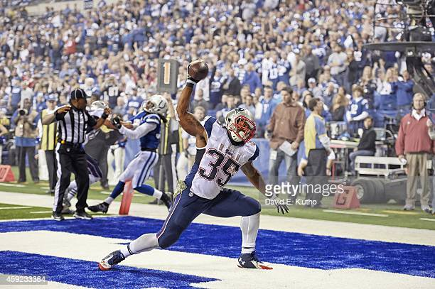 New England Patriots Jonas Gray victorious spiking ball in endzone after scoring his fourth touchdown vs Indianapolis Colts during 4th quarter at...