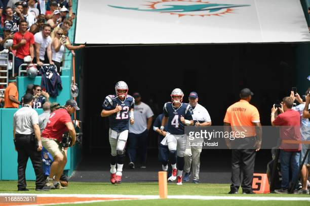 New England Patriots QB Tom Brady and QB Jarrett Stidham taking field before game vs Miami Dolphins at Hard Rock Stadium Miami Gardens FL CREDIT...