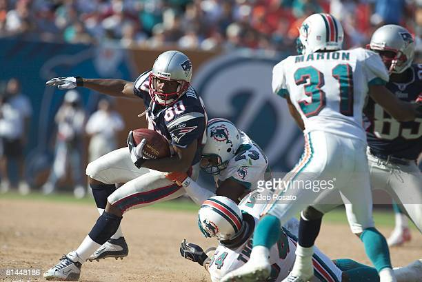 Football New England Patriots Troy Brown in action vs Miami Dolphins Patrick Surtain and Zach Thomas Miami FL
