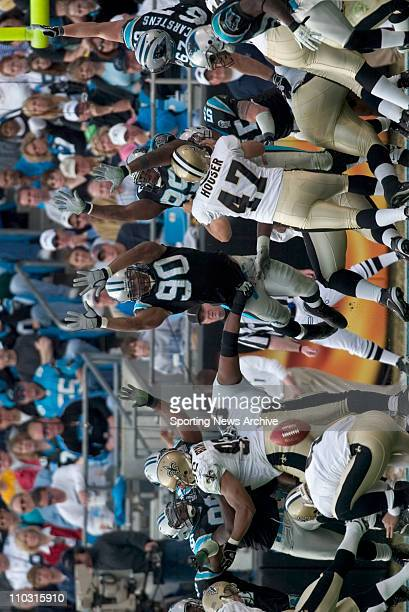 NFL Football New Orleans Saints against Carolina Panthers Julius Peppers Brentson Buckner in Charlotte NC on Jan 2 2005 at Bank of America Stadium...