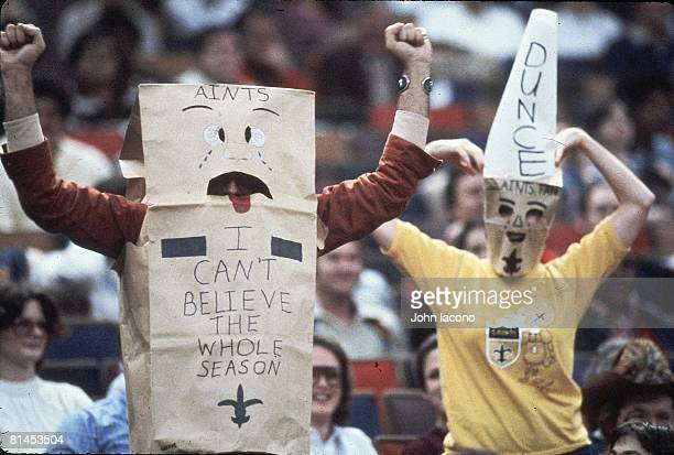 Football New Orleans Saints fans with brown paper bag and AINTS sign in stands during game vs Los Angeles Rams New Orleans LA