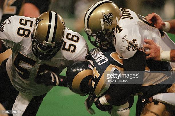 Football New Orleans Saints Joe Johnson and Charlie Clemons in action making tackle vs St Louis Rams Trung Canidate St Louis MO