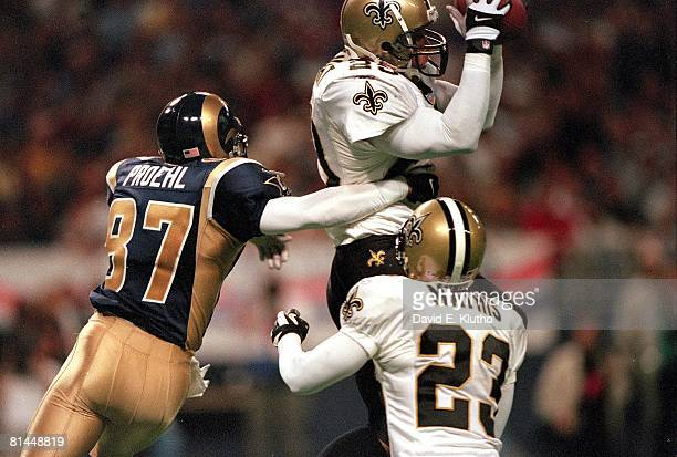 Football New Orleans Saints Sammy Knight in action making interception vs St Louis Rams Ricky Proehl St Louis MO