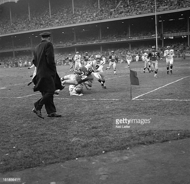 New York Giants Harland Svare in action vs Washington Redskins Ralph Guglielmi at Yankee Stadium Bronx NY CREDIT Neil Leifer