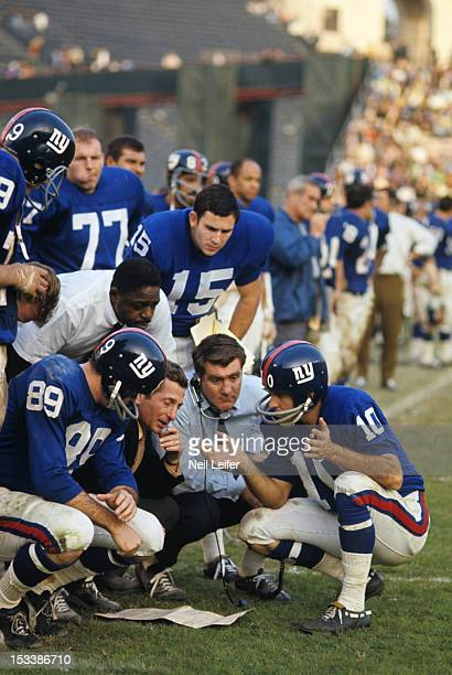 New York Giants head coach Allie Sherman with Bobby Crespino QB Fran Tarkenton and teammates on sidelines during game vs Los Angeles Rams at Los...