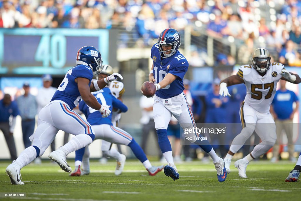 New York Giants QB Eli Manning in action, handing ball off