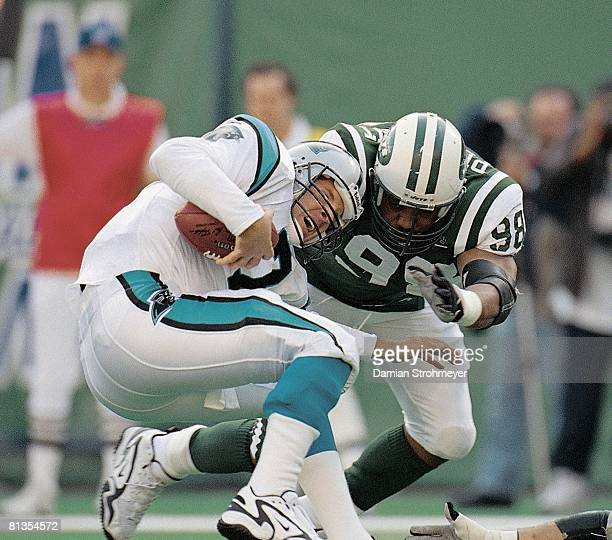 Football New York Jets Anthony Pleasant in action making sack vs Carolina Panther QB Steve Beuerlein East Rutherford NJ