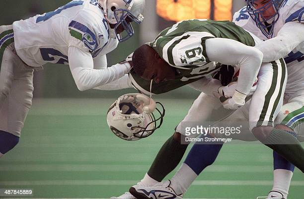 New York Jets Keyshawn Johnson in action vs Seattle Seahawks Shawn Springs at The Meadowlands Johnson losing helmet East Rutherford NJ CREDIT Damian...