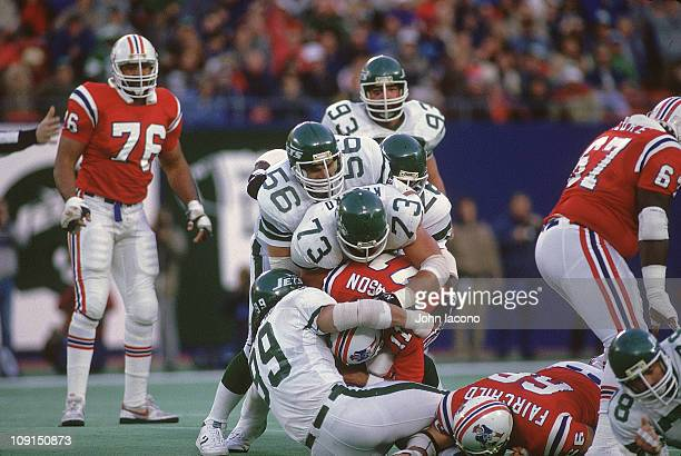New York Jets Lance Mehl Joe Klecko Mark Gastineau and Lester Lyles in action making sack vs New England Patriots QB Tony Eason at The...