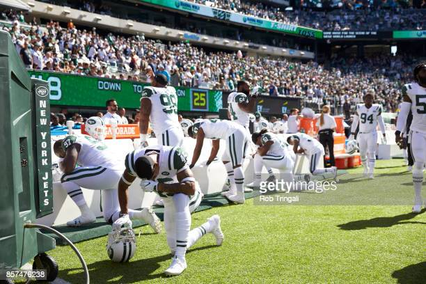 New York Jets players down on one knee praying before game vs Jacksonville Jaguars at MetLife Stadium East Rutherford NJ CREDIT Rob Tringali