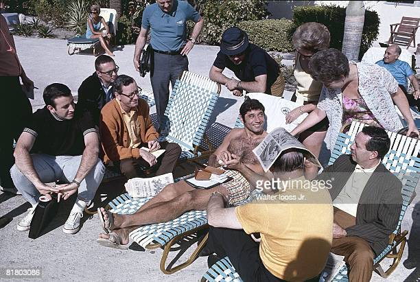Football New York Jets QB Joe Namath casual on beach with media and fans before Super Bowl III game vs Baltimore Colts View of Brent Musburger Fort...