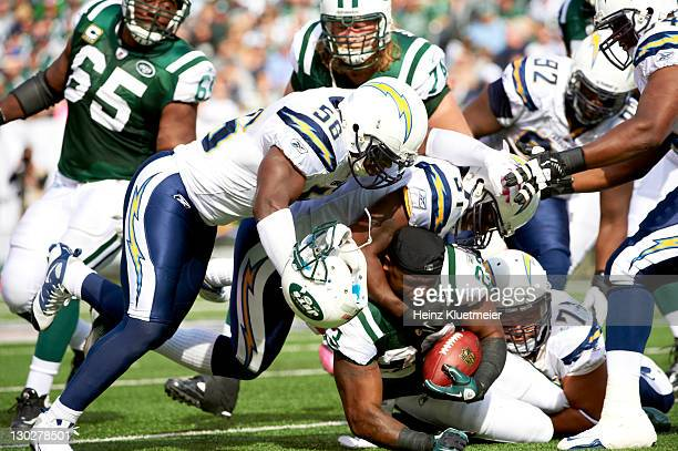 New York Jets Shonn Greene in action vs San Diego Chargers Takeo Spikes and Donald Butler at MetLife Stadium. Greene loses helmet. East Rutherford,...