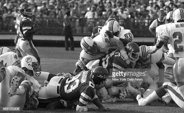 Football New York Jets v Miami Dolphins at Shea Stadium In one of few bright spots for Jets Mike Augustyniak scores in 2d period