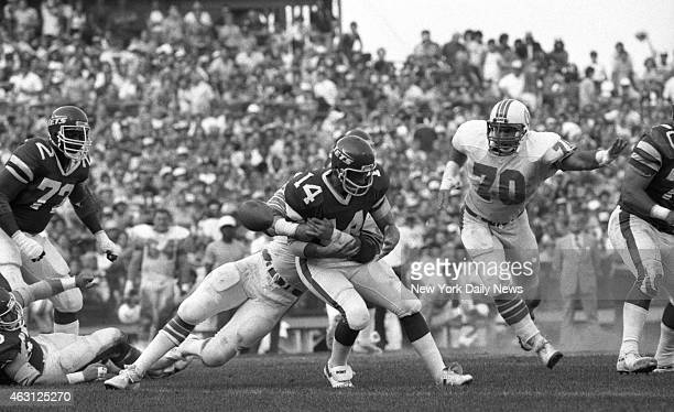 Football New York Jets v Miami Dolphins at Shea Stadium Richard Todd is hit as he rolls back He fumbled and ball was picked up by Bill Barnett Dan...