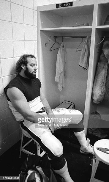 Football New York Jets vs New England Patriots at Giant Stadium PICTURE OF DEJECTION Marty Lyons sits slumped in Jets lockerroom pondering what might...