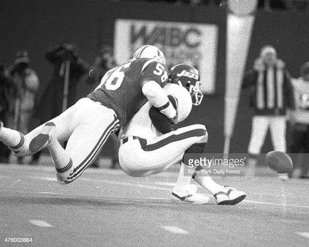 Football New York Jets vs New England Patriots at Giant Stadium Patriots' Andre Tippett has O'Brien all wrapped up as ball squirts away