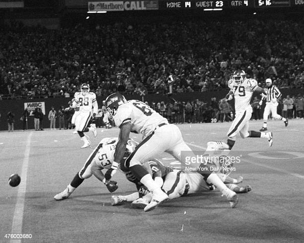 Football New York Jets vs New England Patriots at Giant Stadium The ball is loose and Reggie McElroy and Jim Sweeney are closest to picking it up