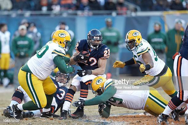 NFC Championship Chicago Bears Matt Forte in action tackle by Green Bay Packers Desmond Bishop BJ Raji and Ryan Pickett at Soldier FieldChicago IL...