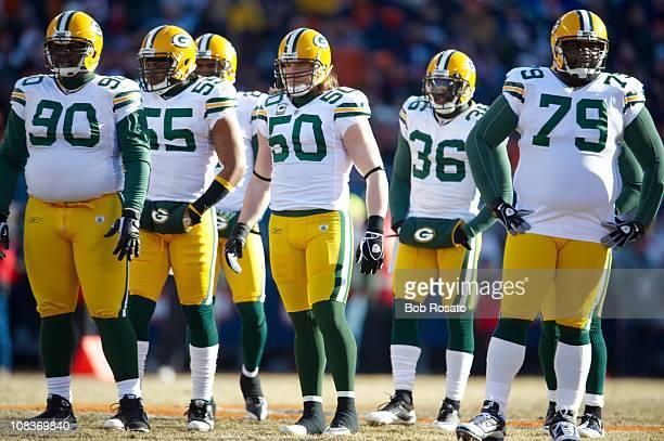 Championship: Green Bay Packers defense B.J. Raji , Desmond Bishop , A.J. Hawk , Nick Collins , and Ryan Pickett on field during game vs Chicago...