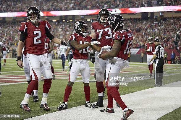 NFC Playoffs Atlanta Falcons QB Matt Ryan Taylor Gabriel Ryan Schraeder and Mohamed Sanu victorious during game vs Seattle Seahawks game at Georgia...