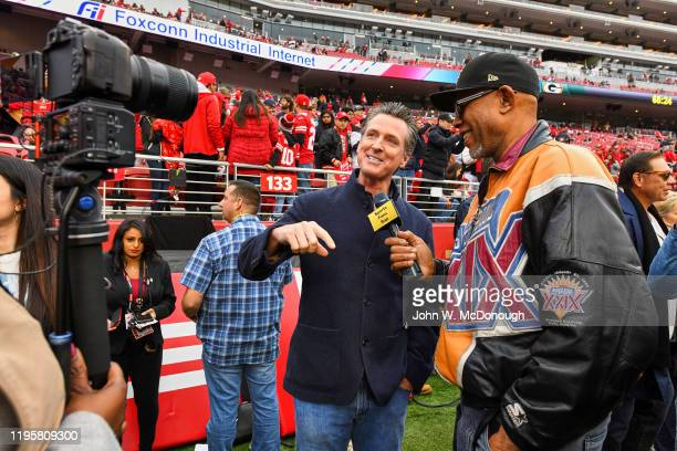 NFC Playoffs California governor Gavin Newsom during interview on field before San Francisco 49ers vs Green Bay Packers game at Levis Stadium Santa...