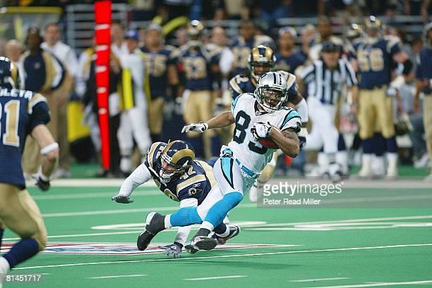 Football: NFC playoffs, Carolina Panthers Steve Smith in action, scoring winning overtime TD vs St, Louis Rams Jason Sehorn , St, Louis, MO 1/10/2004