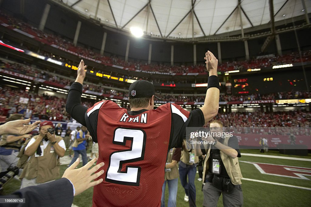 Closeup from rear of Atlanta Falcons QB Matt Ryan (2) victorious on field after winning game vs Seattle Seahawks at Georgia Dome. Simon Bruty F119 )