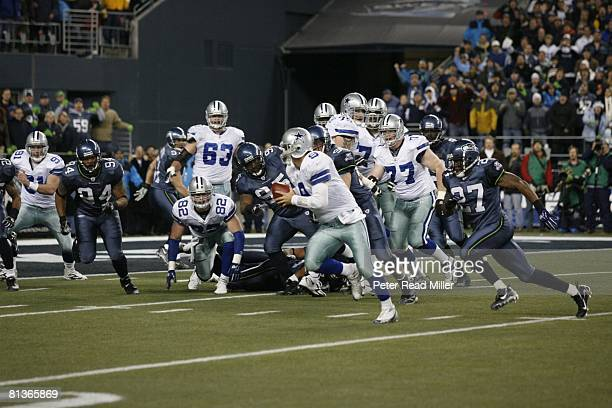 Football NFC Playoffs Dallas Cowboys QB Tony Romo in action rushing after dropping field goal snap vs Seattle Seahawks Cowboys lost game Seattle WA...