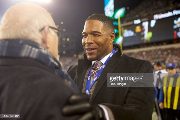 NFC Playoffs Fox Sports analyst Michael Strahan on field with Fox Sports analyst Terry Bradshaw after Philadelphia Eagles vs Minnesota Vikings game...