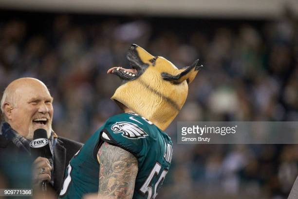 NFC Playoffs Fox Sports analyst Terry Bradshaw with Philadelphia Eagles Chris Long victorious wearing dog mask during NFC Championship trophy...