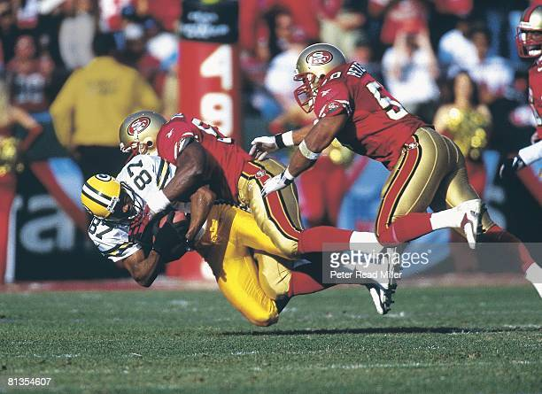 Football NFC Playoffs Green Bay Packers Robert Brooks in action during tackle vs San Francisco 49ers Lee Woodall and Anthony Peterson San Francisco...