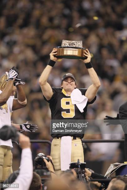 NFC Playoffs New Orleans Saints QB Drew Brees victorious holding up George Halas Trophy after game vs Minnesota Vikings New Orleans LA 1/24/2010...