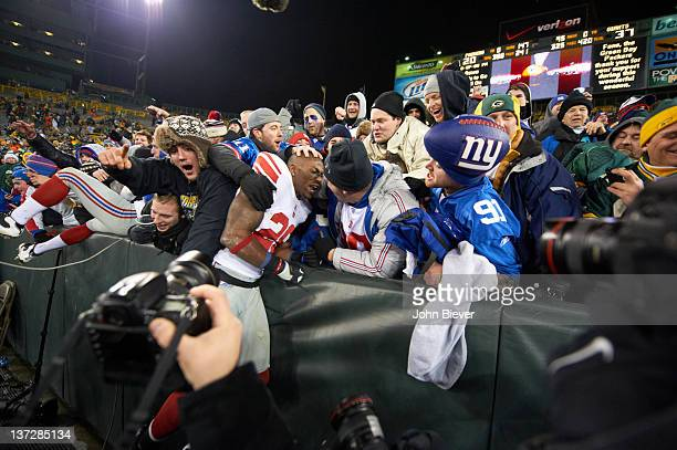Playoffs: New York Giants Antrel Rolle victorious with fans in stands during game vs Green Bay Packers at Lambeau Field. Green Bay, WI 1/15/2012...