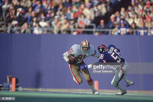 Football NFC playoffs New York Giants Lawrence Taylor in action vs San Francisco 49ers Russ Francis East Rutherford NJ