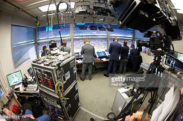 NFC Playoffs Overall view from rear of Fox Sports announcers Joe Buck and Troy Aikman in booth with rules expert and former NFL vice president of...