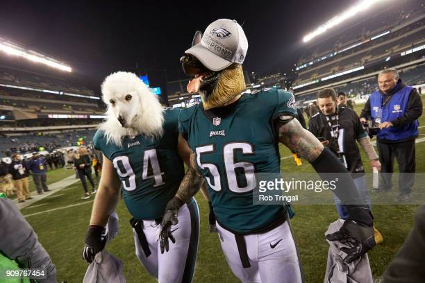 NFC Playoffs Philadelphia Eagles Beau Allen and Chris Long victorious wearing dog masks as they walk off field after winning game vs Minnesota...