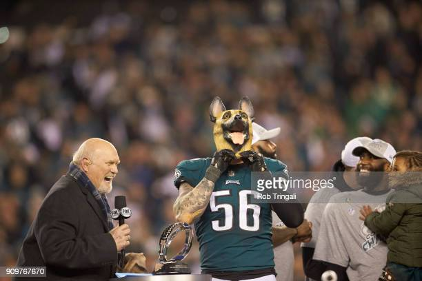 NFC Playoffs Philadelphia Eagles Chris Long victorious wearing dog mask during NFC Championship trophy presentation with Fox Sports analyst Terry...