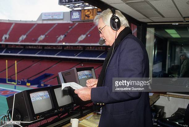 Playoffs: Portrait of CBS Sports announcer Pat Summerall in booth during New York Giants vs San Francisco 49ers game at Giants Stadium. View of John...