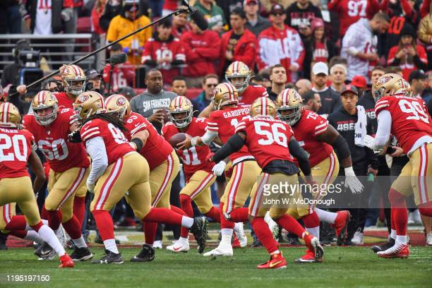 Playoffs: Rear view of San Francisco 49ers QB Jimmy Garoppolo in action, handing off to Raheem Mostert at Levi's Stadium. Santa Clara, CA 1/19/2020...