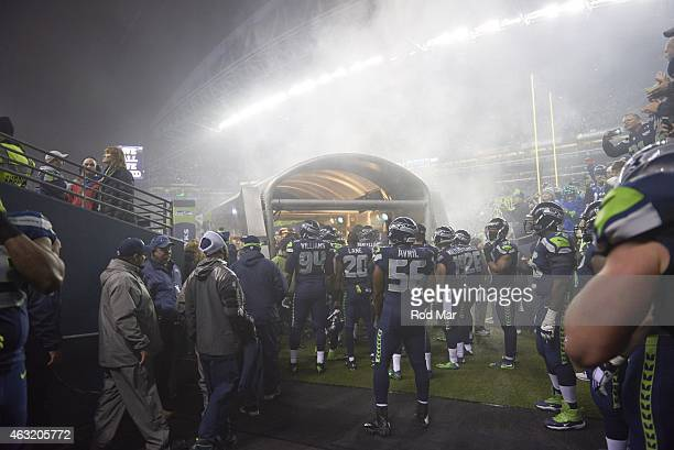 NFC Playoffs Rear view of Seattle Seahawks Kevin Williams Jeremy Lane and Cliff Avril about to take field before game vs Carolina Panthers at...