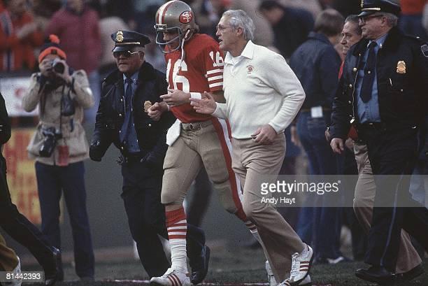 Football NFC Playoffs San Francisco 49ers coach Bill Walsh and QB Joe Montana running onto field before game vs Dallas Cowboys San Francisco CA...