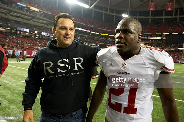 Playoffs: San Francisco 49ers Frank Gore victorious on field with agent Drew Rosenhaus after winning game vs Atlanta Falcons at Georgia Dome....