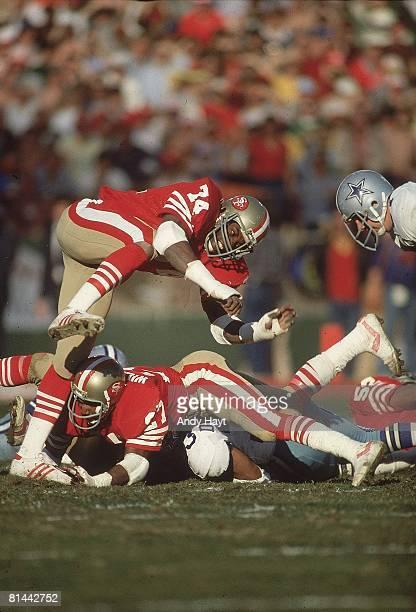 Football NFC Playoffs San Francisco 49ers Fred Dean in action playing defense during pileup tackle vs Dallas Cowboys San Francisco CA 1/10/1982